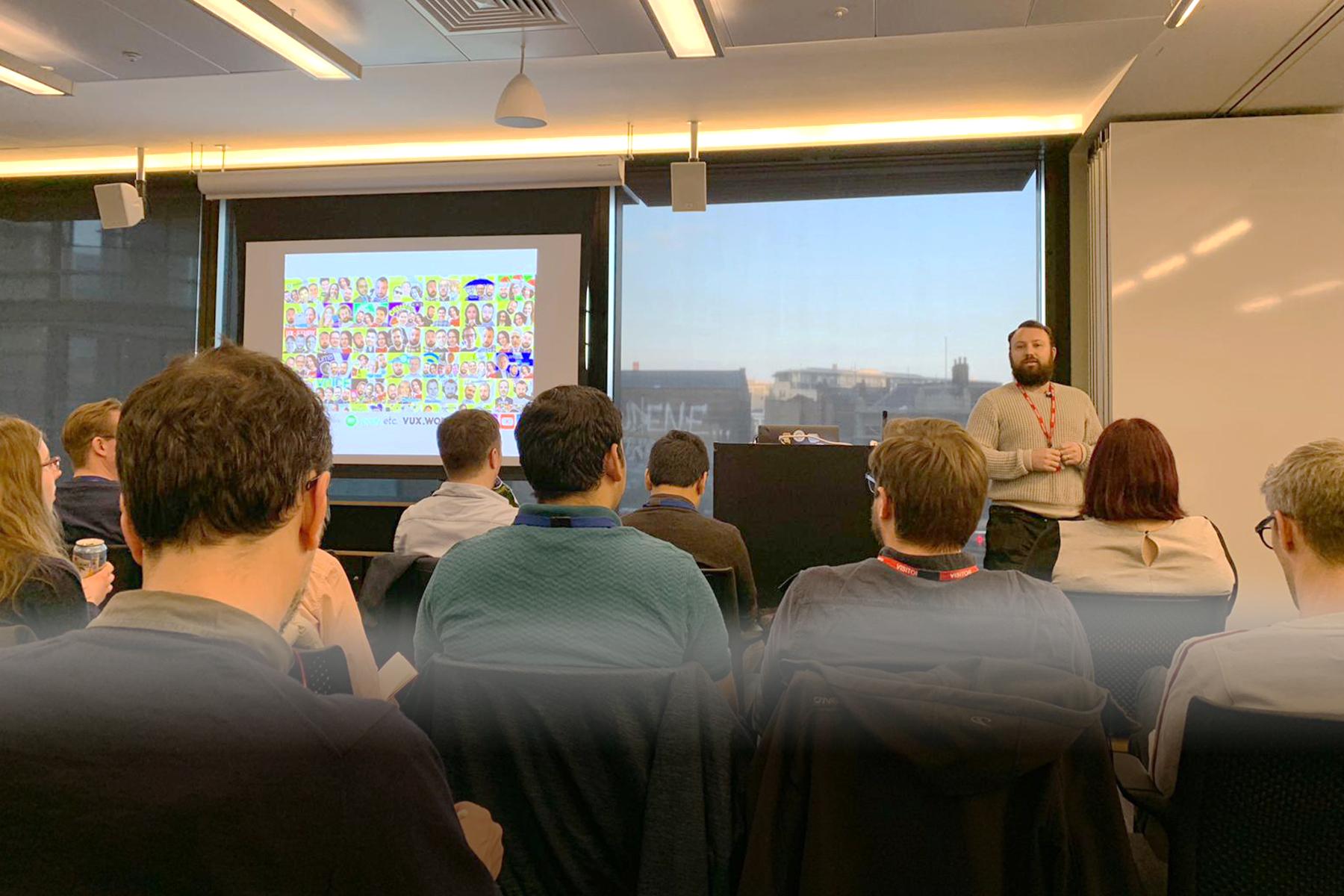 Kane Simms of VUX World presenting at the MUXL meet up at Amazon HQ London